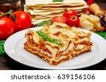 portion of tasty lasagna on... | Shutterstock . vector #639156106