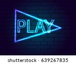a neon sign in button to play... | Shutterstock .eps vector #639267835