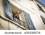 Small photo of Algiers, Algeria - March 28, 2017: Algerian woman looking out of window in Algiers city, Algeria
