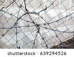 barbed wire | Shutterstock . vector #639294526