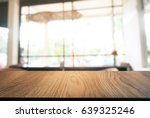 Image Of Wood Table In Front O...