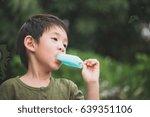 cute asian child eating blue...   Shutterstock . vector #639351106
