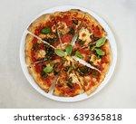 fresh vegetarian pizza on a... | Shutterstock . vector #639365818