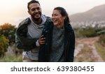 portrait of couple walking... | Shutterstock . vector #639380455