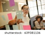 business woman pointing at... | Shutterstock . vector #639381136