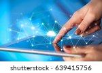 female hands touching tablet... | Shutterstock . vector #639415756