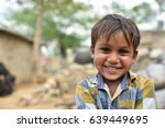 Small photo of Smiling face portrait of a young child or young boy from rural part of India
