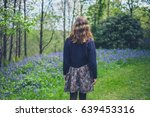 a young woman is walking in a... | Shutterstock . vector #639453316