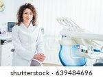 portrait of female dentist. she ... | Shutterstock . vector #639484696