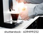 man making black coffee in...   Shutterstock . vector #639499252