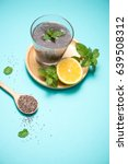 Small photo of Selective focus of chia seeds drink with water in transparent glass with lemon balm.