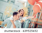 happy young couple hugging and... | Shutterstock . vector #639525652