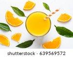 orange juice in glass and fresh ... | Shutterstock . vector #639569572