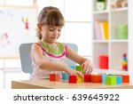 child girl playing with block... | Shutterstock . vector #639645922