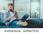 confident bearded man is... | Shutterstock . vector #639667525