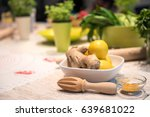 ginger and lemon in bowl with... | Shutterstock . vector #639681022