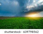 storm clouds overt sunny wheat...   Shutterstock . vector #639798562