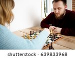 couple playing chess. | Shutterstock . vector #639833968