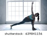 young woman doing yoga pose... | Shutterstock . vector #639841156