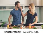 young couple cooking together... | Shutterstock . vector #639843736