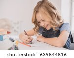 little kid girl drawing at home ... | Shutterstock . vector #639844816