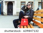 woman sitting on the bench with ... | Shutterstock . vector #639847132