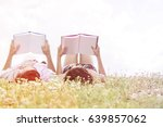 relaxed young couple reading...   Shutterstock . vector #639857062