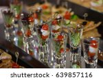 appetizers on plates ready for... | Shutterstock . vector #639857116