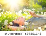 beautiful young woman lying on... | Shutterstock . vector #639861148