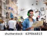 man travels with map . young... | Shutterstock . vector #639866815