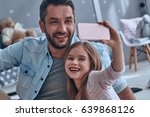 smile  young father and his... | Shutterstock . vector #639868126