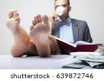 Small photo of Successful happy young businessman with bare feet works in office. (Boss, business, rules, officialdom concept)
