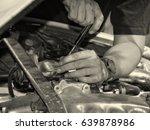 man at work in a garage. auto... | Shutterstock . vector #639878986