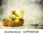 pickled green gherkins  | Shutterstock . vector #639900538