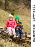 two little kids sitting on a... | Shutterstock . vector #639946582