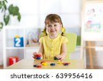kid girl playing with logical... | Shutterstock . vector #639956416