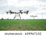 Small photo of Agriculture drone flying on the green corn field
