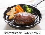 shoot a homemade hamburger steak | Shutterstock . vector #639972472