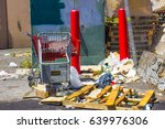 Small photo of Shopping Carts Next To Trash Pile