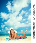 beautiful woman at the beach in ... | Shutterstock . vector #640000096