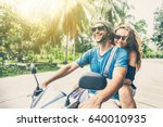 young beautiful couple rides... | Shutterstock . vector #640010935