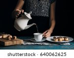 the girl at the table pours the ... | Shutterstock . vector #640062625