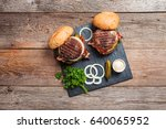 two fresh homemade burgers on... | Shutterstock . vector #640065952