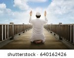 young asian muslim man raising... | Shutterstock . vector #640162426