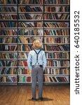 little child in library | Shutterstock . vector #640185532