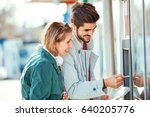 young tourist couple using atm... | Shutterstock . vector #640205776