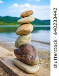photo of stones balanced on top ... | Shutterstock . vector #640233442
