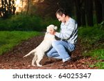 Stock photo golden retriever and man are playing in park 64025347