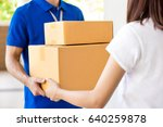 delivery man delivering parcel... | Shutterstock . vector #640259878