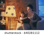 family reading bedtime. pretty... | Shutterstock . vector #640281112